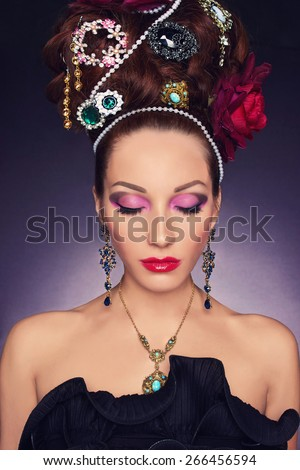 beautiful young woman with accessories.fashionable girl.Elegant Lady with jewelry in hair
