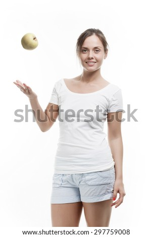 Beautiful Young Woman with an Apple - stock photo
