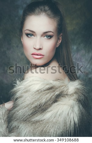 beautiful young woman with artificial fur  portrait, studio shot, front view - stock photo