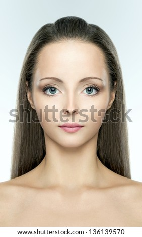 Beautiful young woman with big blue eyes - stock photo
