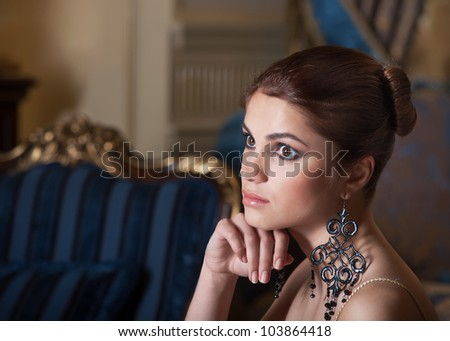 Beautiful young woman with big eyes - stock photo
