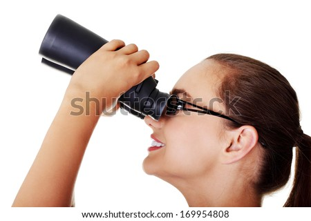 Beautiful young woman with binoculars. Isolated on white. - stock photo