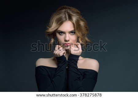 beautiful young woman with blond hair.beauty Girl in black dress - stock photo