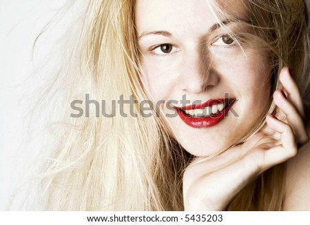 Beautiful young woman with blond long hair. White background.