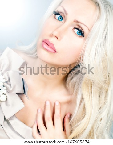 beautiful young woman with blue eyes and long curly blond hair  - stock photo