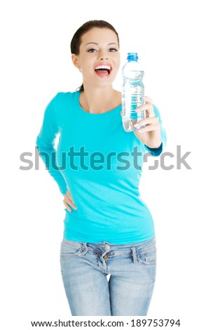 Beautiful young woman with bottle of mineral water, isolated on white - stock photo