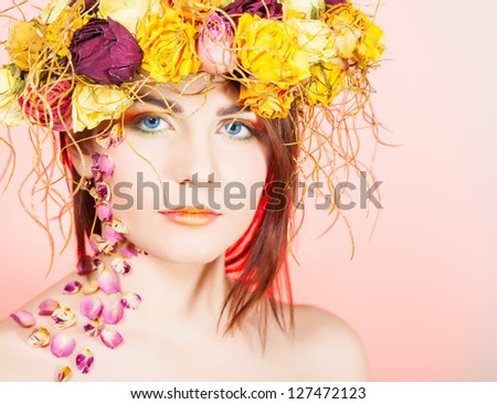 Beautiful young woman with breath on her head