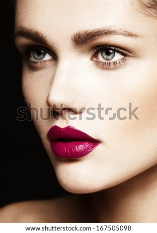 Beautiful young woman with bright make-up. Close-up beauty portrait  - stock photo