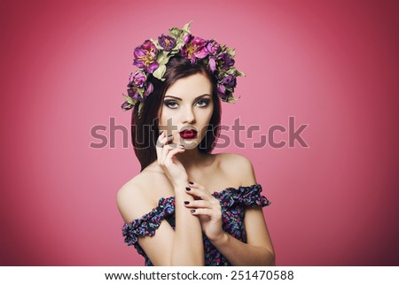 beautiful young woman with bright makeup wearing floral headband - stock photo