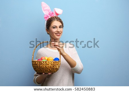 Easter gift stock images royalty free images vectors shutterstock beautiful young woman with bunny ears and basket full of easter eggs on light background negle Images
