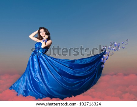 Beautiful young woman with butterfly in blue dress. Collage - stock photo