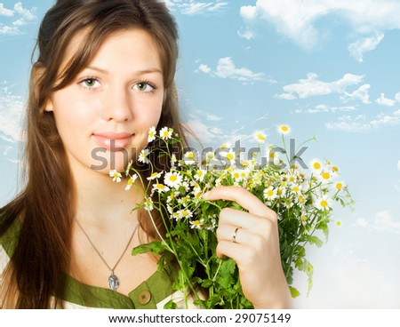 Beautiful young woman with camomiles