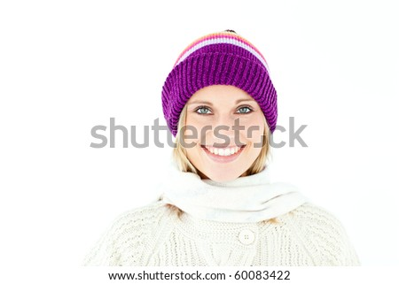 Beautiful young woman with cap in the winter smiling at the camera against a white background - stock photo