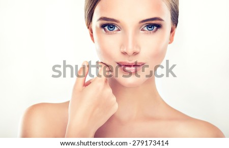 Beautiful Young Woman with Clean Fresh Skin close up - stock photo