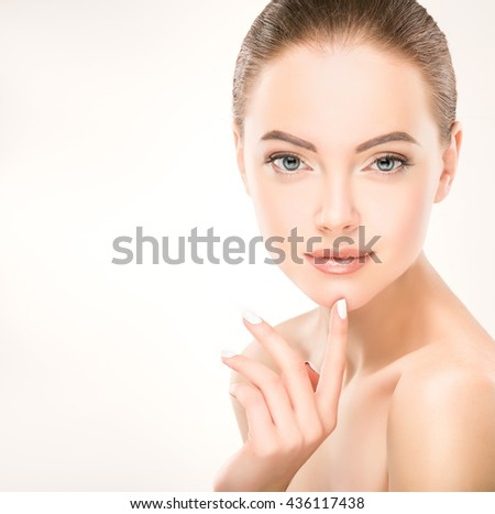Beautiful Young Woman with Clean Fresh Skin . Facial  treatment   . Cosmetology , beauty  and spa    - stock photo
