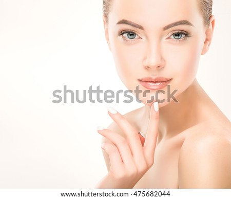 Beautiful Young Woman with Clean Fresh Skin . Facial  treatment   . Cosmetology , beauty  and spa