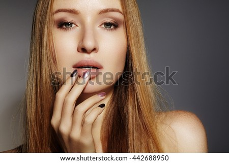 Beautiful young woman with clean skin, beautiful straight shiny hair, fashion makeup. Glamour make-up, perfect shape eyebrows. Portrait sexy blondy. Beautiful smooth hairstyle. Shiny nail polish  - stock photo