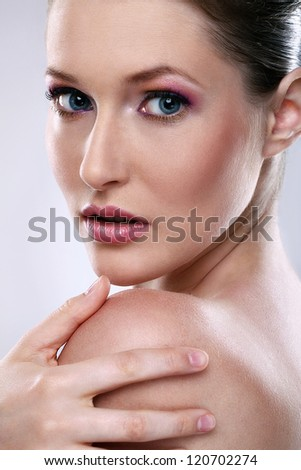 Beautiful young woman with clean skin face portrait