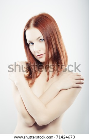 Beautiful young woman with clean skin of the face. - stock photo
