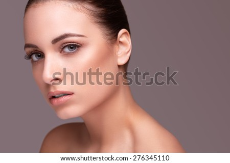 Beautiful young woman with clean skin of the face. Skin Care - stock photo
