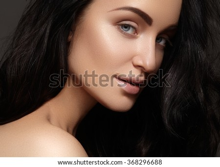 Beautiful young woman with clean skin, shiny hair, fashion makeup. Glamour make-up, perfect shape eyebrows. Portrait sexy brunette - stock photo
