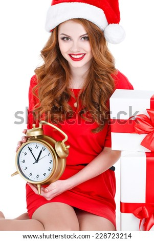 beautiful young woman with clock, isolated on white. portrait of a beautiful young woman at Christmas holding a clock. Santa Girl Looks Down At Clock As It Nears Christmas - stock photo