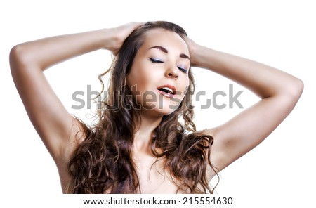 beautiful young woman with closed eyes, isolated on white studio background - stock photo