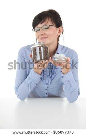 beautiful young woman with coffee beans in glass pot, white background