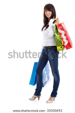 Beautiful, young, woman with colorful shopping bags in her hand