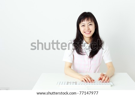 beautiful young woman with computer - stock photo