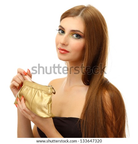 Beautiful young woman with cosmetics bag and lipstick - stock photo