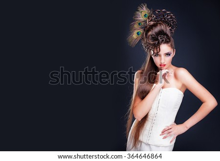 Beautiful young woman with creative fashion hairstyle. Spanish flamenco hairstyle. Creative makeup - stock photo