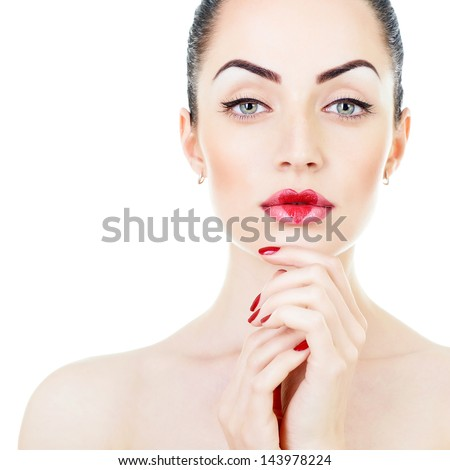 Beautiful young woman with creative makeup with heart on her lips posing at studio over white background - stock photo