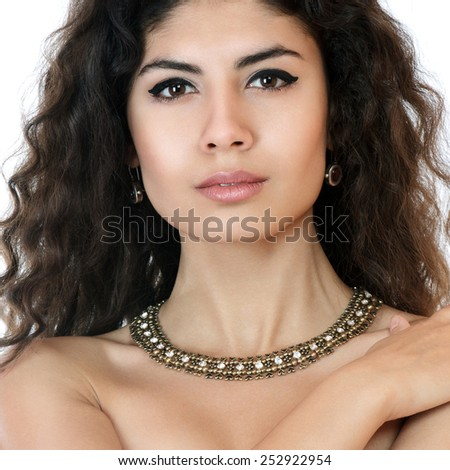 Beautiful young woman with crossed arms studio shot - stock photo