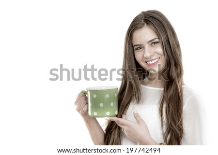 Beautiful young woman with cup of coffee, isolated on white background - stock photo
