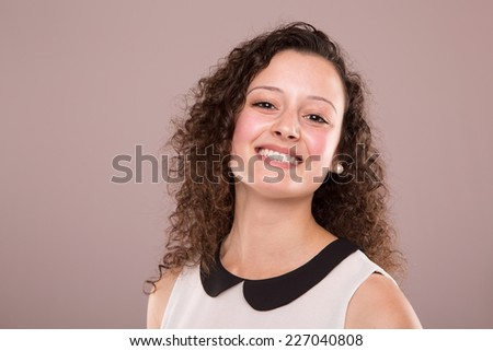 Beautiful young woman with curly hair posing