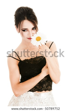 Beautiful young woman with daisy flower
