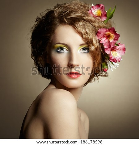 Beautiful young woman with delicate flowers in their hair. Spring photos - stock photo