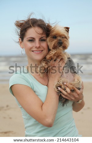 beautiful young woman with dog - stock photo