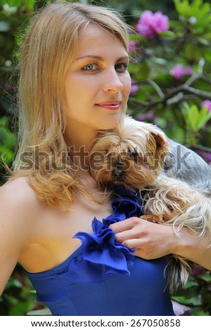 beautiful young woman with dog in park - stock photo