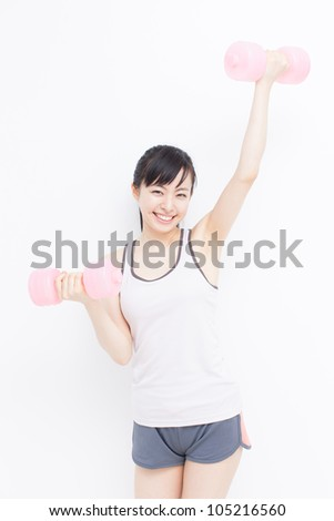 beautiful young woman with dumbbells against white background - stock photo