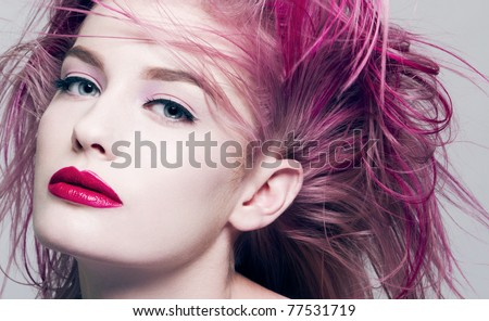Beautiful young woman with dyed purple hair - stock photo