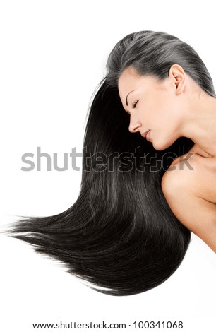beautiful young woman with elegant long shiny hair , concept hairstyle - stock photo