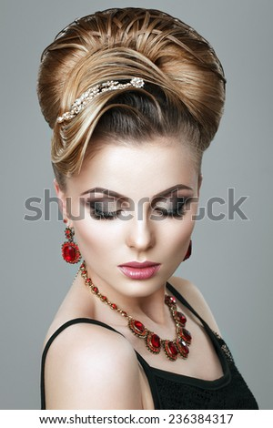 Beautiful young woman with evening make-up and salon hairdo . Smoky eyes. Complicated hairstyle for party