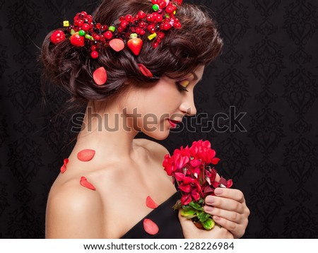 Beautiful young woman with evening make-up in the style of the summer with flowers - stock photo