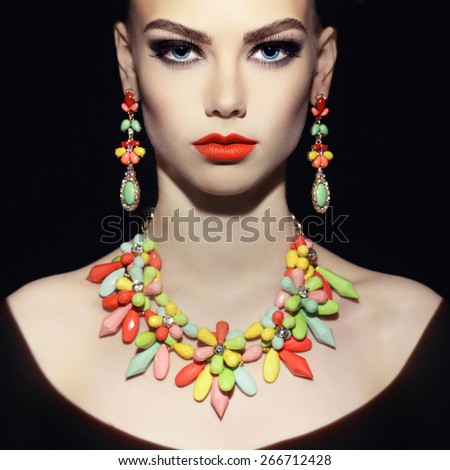 Beautiful young woman with evening make-up. Jewelry and Beauty. Fashion photo - stock photo