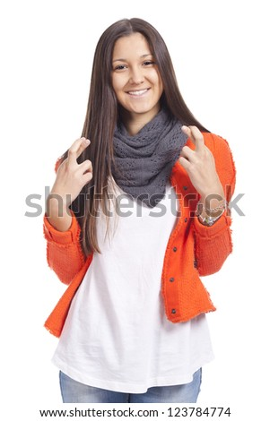 beautiful young woman with fingers crossed - stock photo