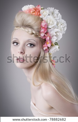 Beautiful young woman with flower - stock photo