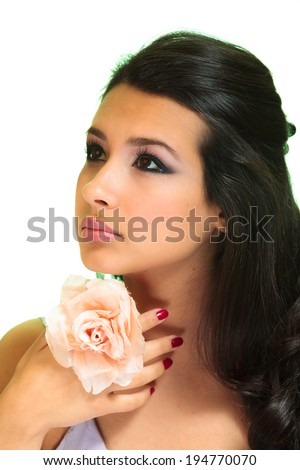 Beautiful young woman with flower on a white background.