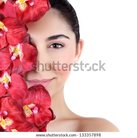 Beautiful young woman with fresh red orchid flowers on half of face isolated on white background, luxury spa salon - stock photo